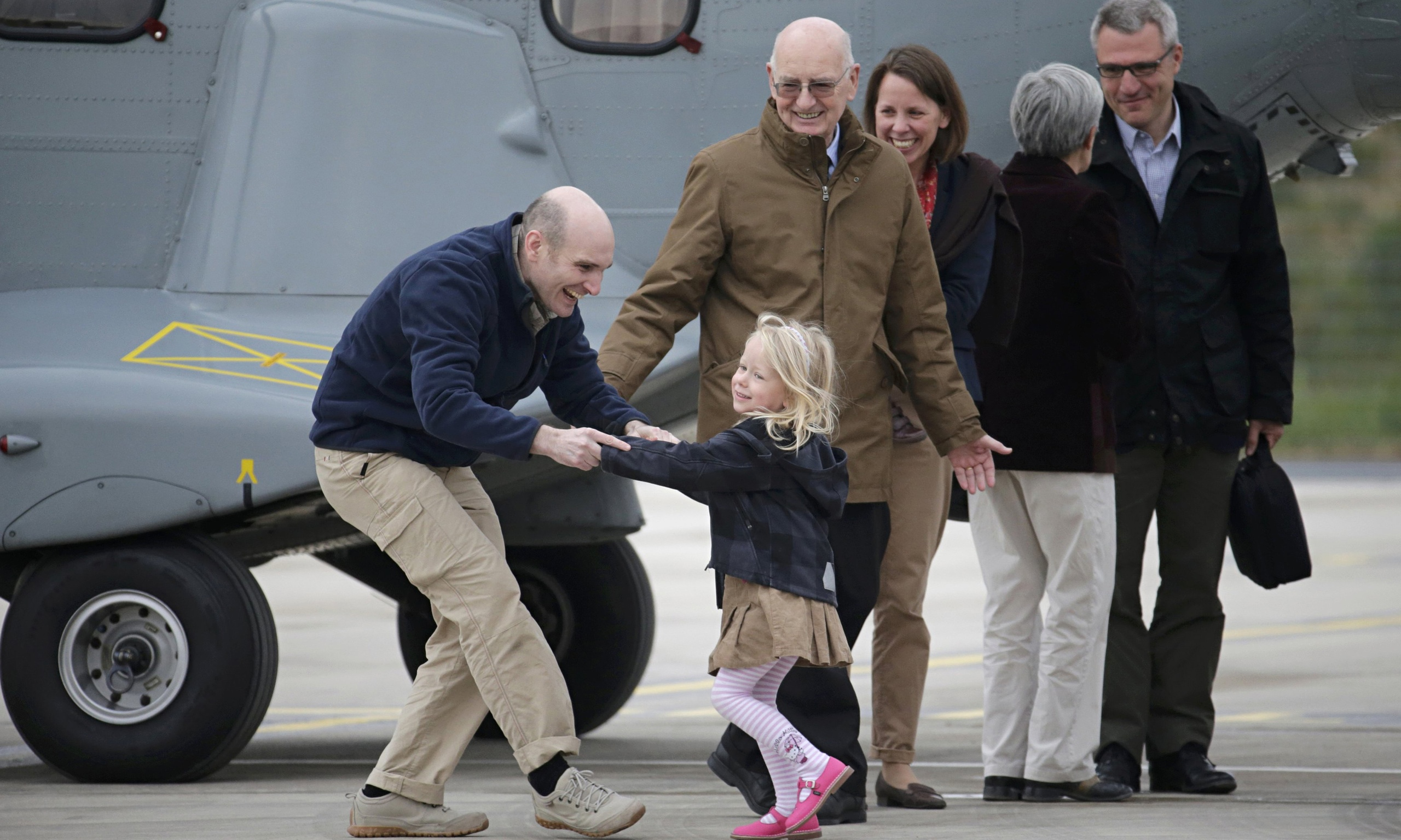 Nicolas Henin is greeted by his family in April 2014.