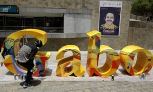 epa04956544 An artist sprays a graffiti on the letter sculpture of the name 'Gabo' in honor of late Colombian writer Gabriel Garcia Marquez as part of preparations for the Gabriel Garcia Marquez Journalism Award ceremony in Medellin, Colombia, 29 September 2015. The ceremony is held as part of the Gabriel Garcia Marquez Festival of Journalism running from 29 September to 01 October. EPA/LUIS EDUARDO NORIEGA
