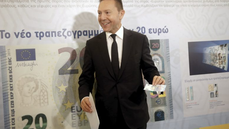 Governor of the Central Bank of Greece Stournaras presents the new 20 Euro banknote at the institution's Museum in Athens
