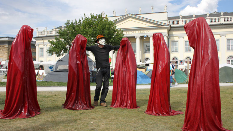 occupy-kassel-art-documenta-shows-guerilla-anonymous-mask-time-guards-sculpture-manfred-kielnhofer
